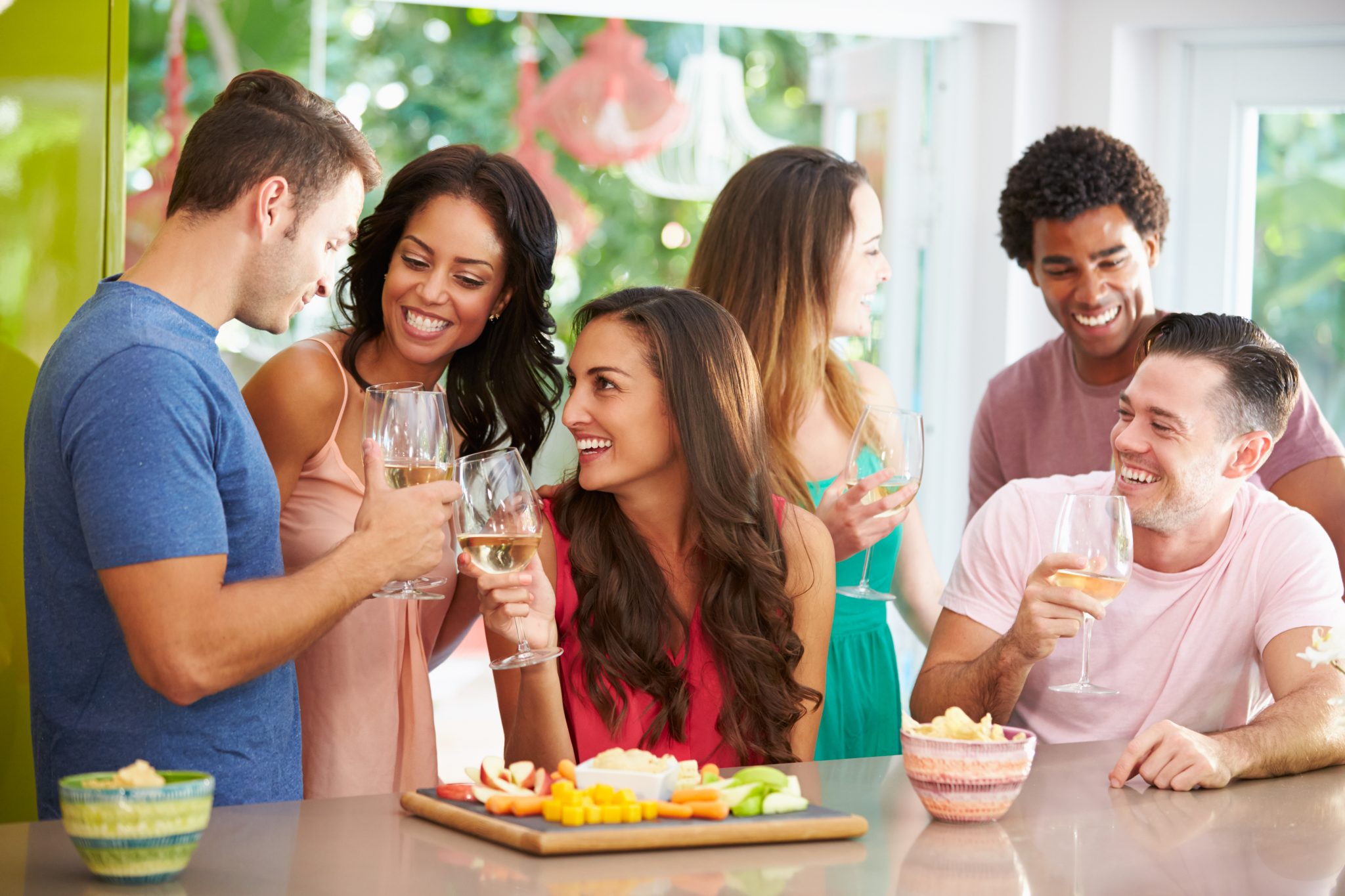 Group Of Friends Enjoying Drinks Party At Home
