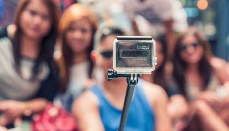 Girls taking selfie with selfie stick
