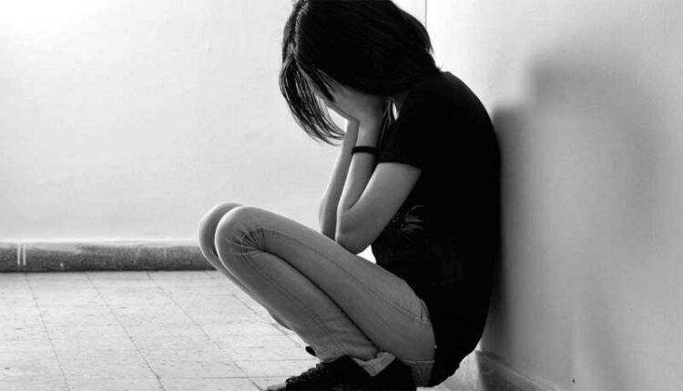 Depressed Girl sitting in Room