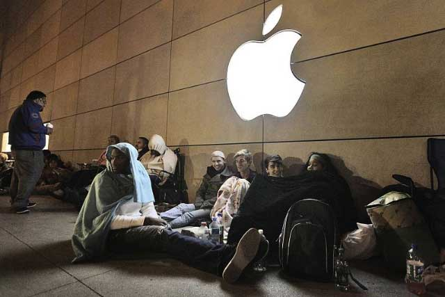 People waiting outside Apple store