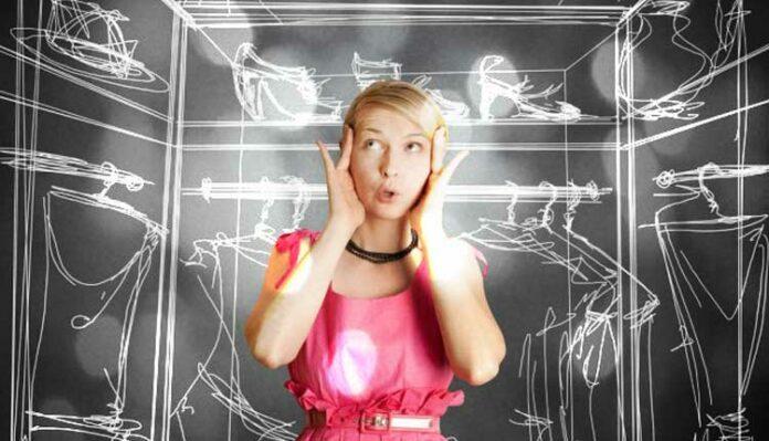 Girl thinking inside wardrobe