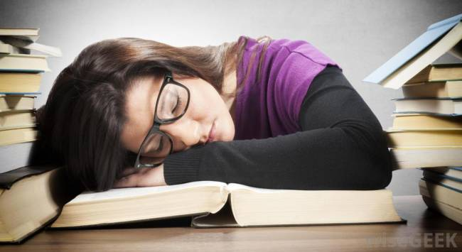 Girl Sleeping on Table on Book