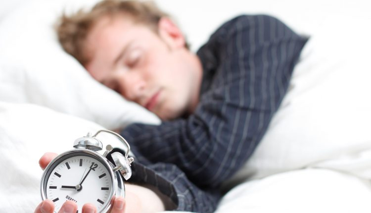 Man Sleeping with Clock