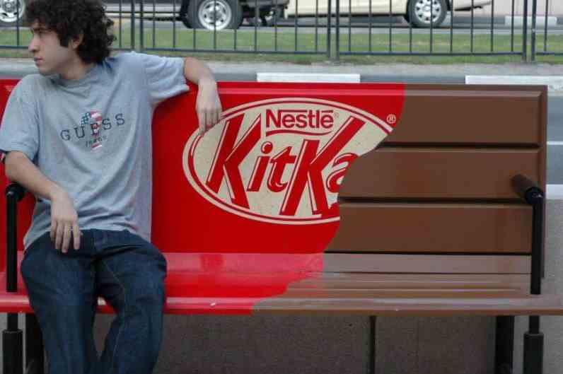 Man sitting on Kit Kat Bench