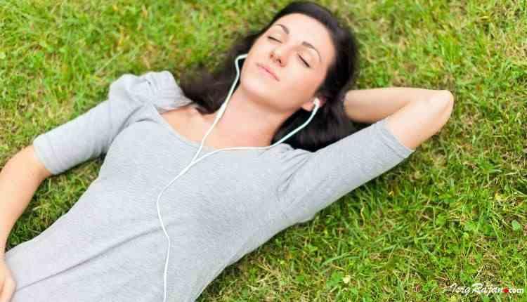music and mood girl lying on grass