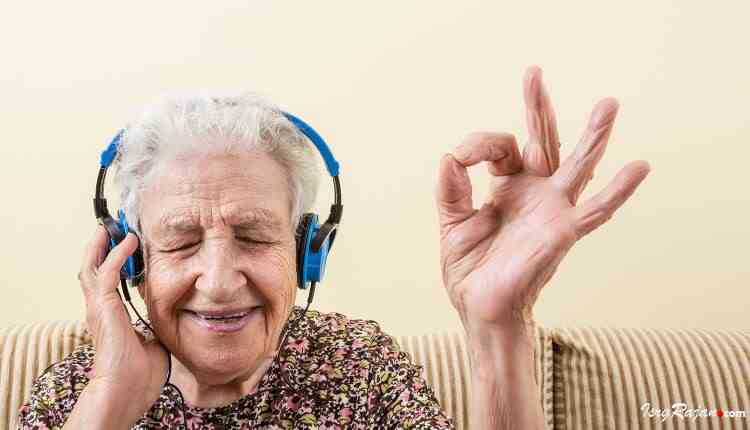 Old woman with headphone