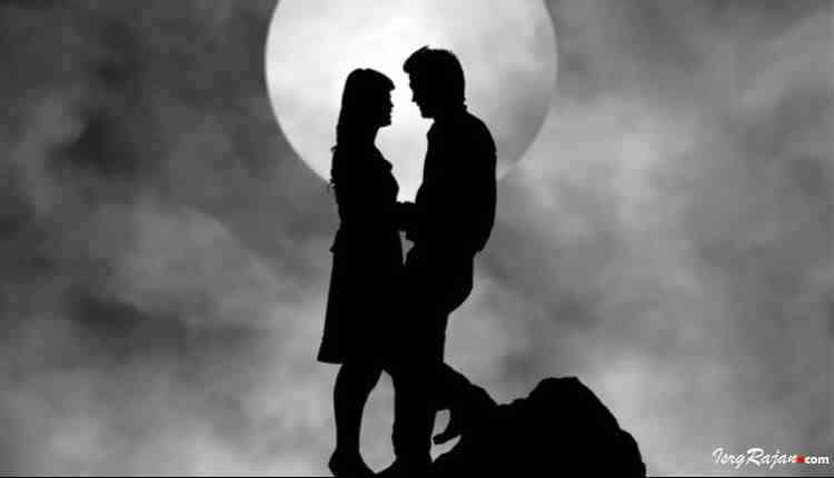 Couples standing together with moon