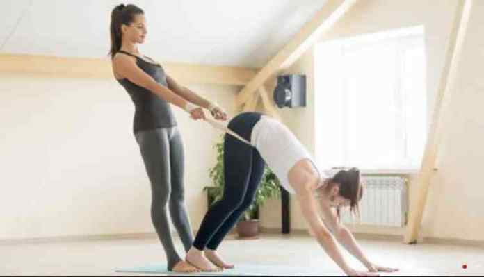 Yoga Instructor Assisting