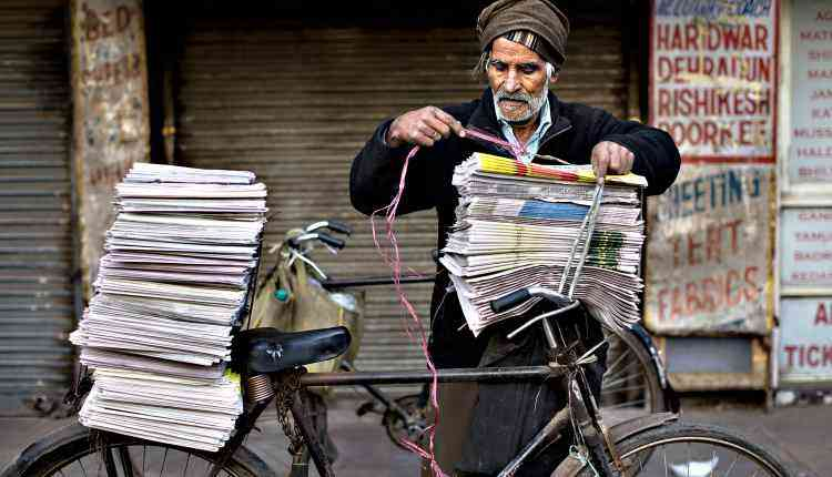 Old man, news seller