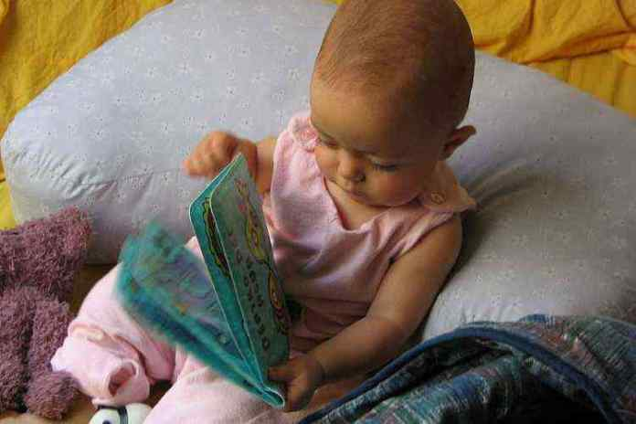 Small baby with book