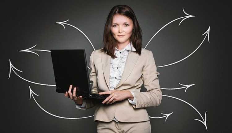 working women, employed women, laptop, standing