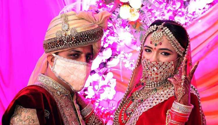 Indian Groom And Bride In Mask